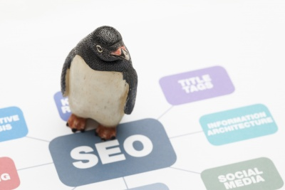 penguin appearing to walk across floor with the words seo on it